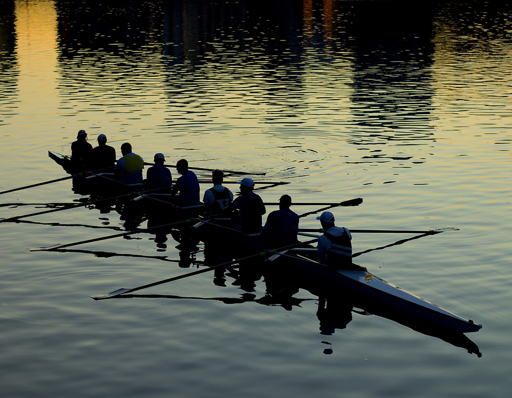 A group rowing a crew boat