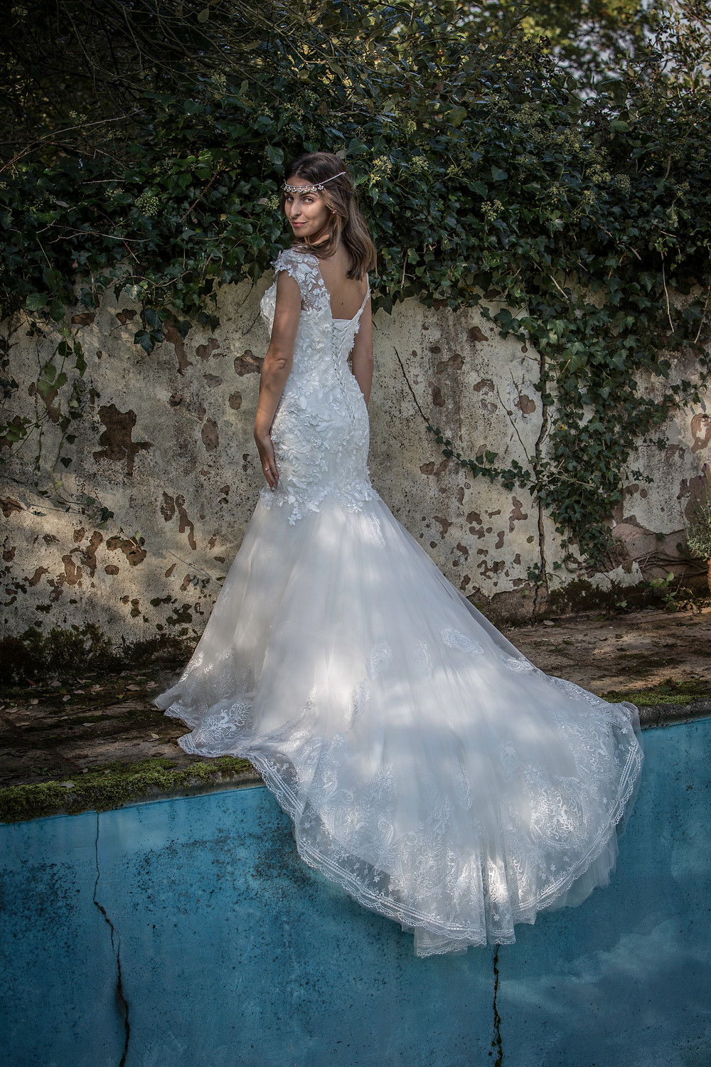Laced Back Fishtail Wedding Dress by abandoned swimming pool Devon Photoshoot by Taunton Weddings