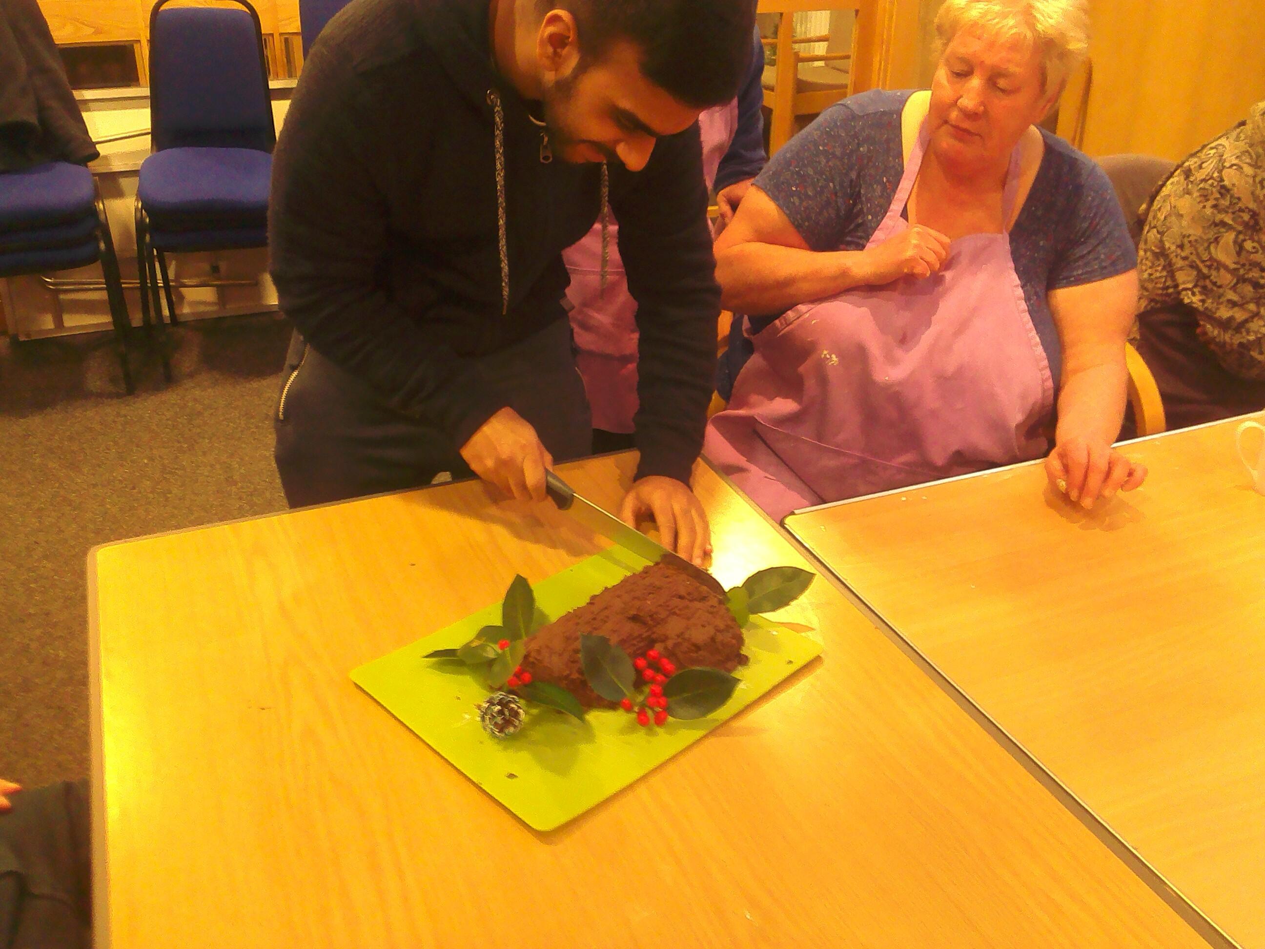Cutting the chocolate log