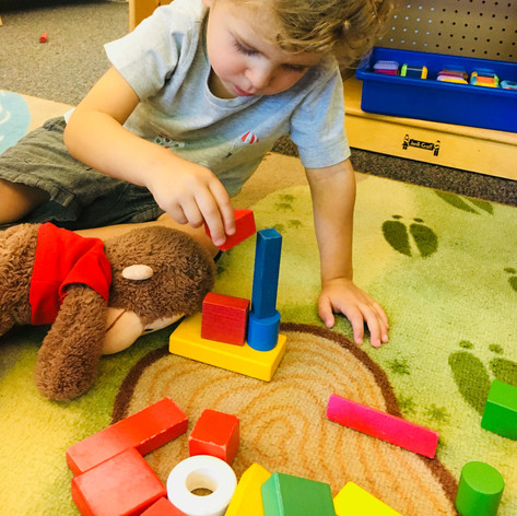 Toddler building with blocks