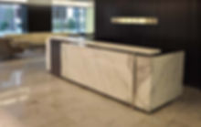 Marble receptionist counter protected by StoneGuard® Stone Surface Protection Film installed by Extreme Window Film Solutions™