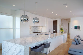 Marble kitchen island protected by StoneGuard® Stone Surface Protection Film installed by Extreme Window Film Solutions™