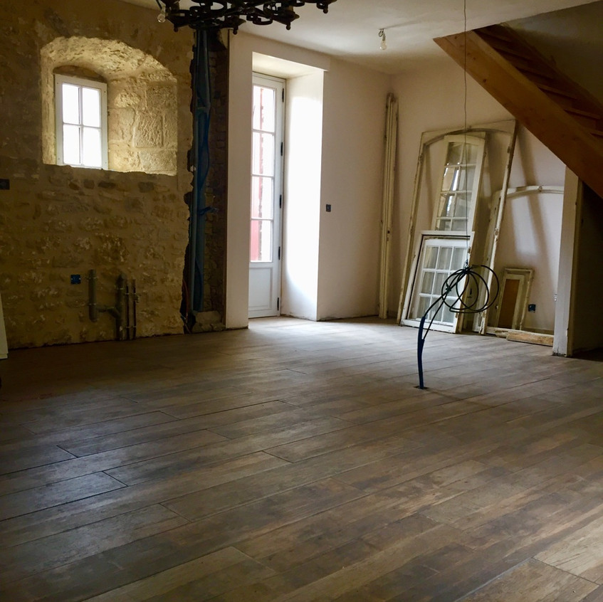 The flooring in the kitchen is done