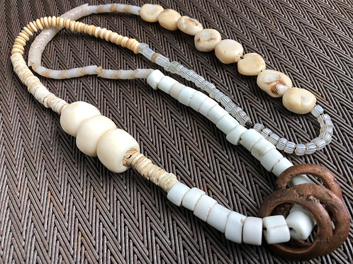BONE, GLASS, BRASS, OSTRICH SHELL, BRASS, SNAKEBEADS