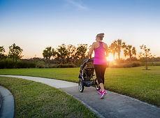 Beautiful, fit women walking and jogging