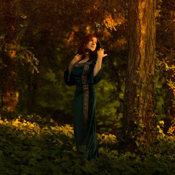 fantasy_girl_in_the_forest_by_the_sunset