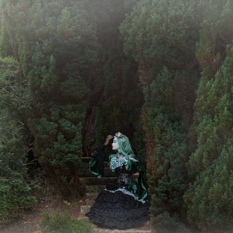 gothic_princess_sitting_by_trees_by_e_a_