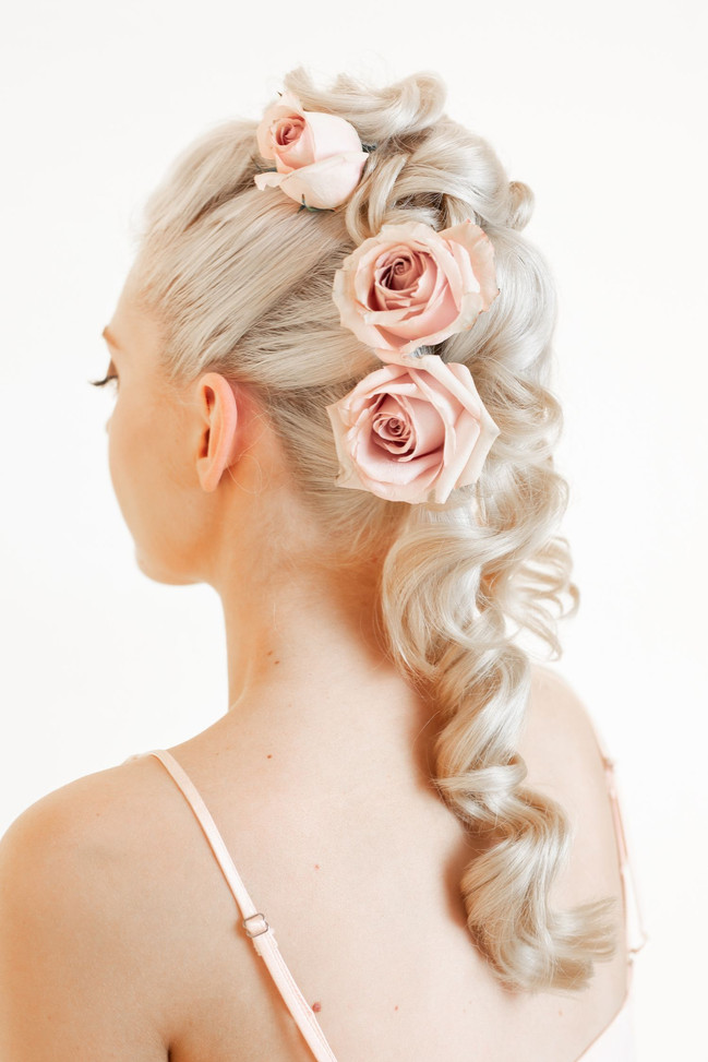 roses in hair , twists , romantic upstyle