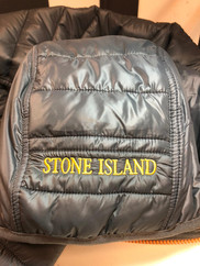 Reparacion plumon stone island