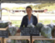 Vendor Krisan with Produce