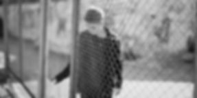 boy_behind_fence_1000_BW.jpg