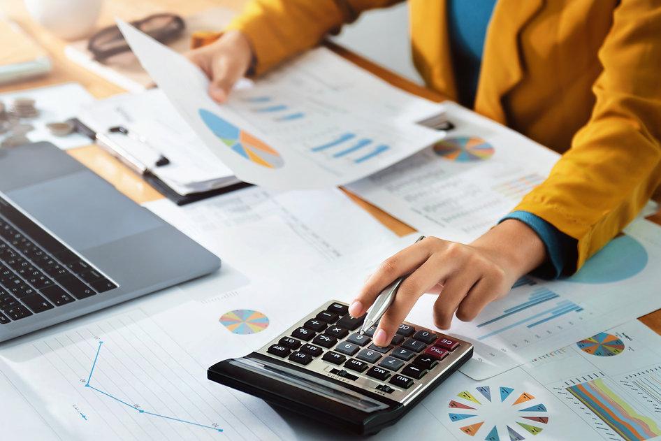 Woman accountant use calculator and comp