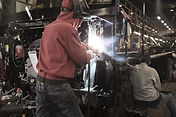 welder working in manufacturing plant.jp