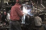welder working in manufacturing plant.jp