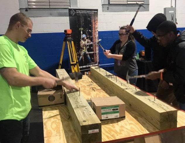 Hammering contest against an apprentice - Ferndale Carpentry Training Center