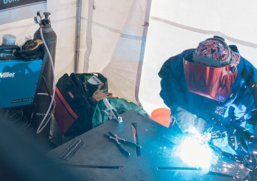 A 13 yr old welder demonstrates MIG seams - Welding Trainig Center