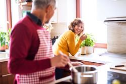 senior-couple-preparing-food-in-the-kitc