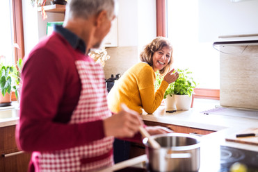 senior-couple-preparing-food-in-the-kitc