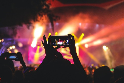 Mobile phone users at concert
