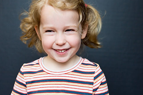 Preschooler portrait, Blonde girl with pig tails, smiles