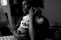 Mother holds newborn baby