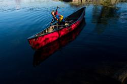 Child paddles canoe solo