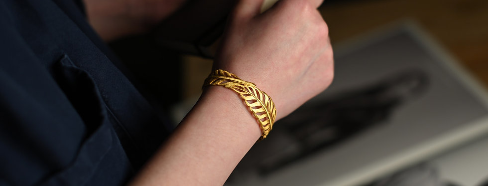 gold feather cuff bracelet