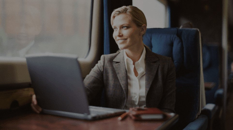 Woman business train smiling.jpg