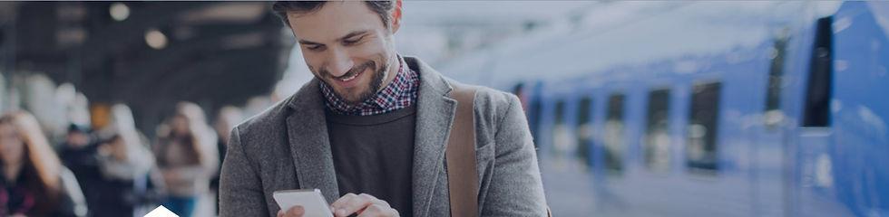 Man smiling phone.jpg
