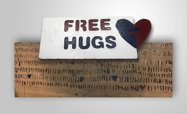 onelovestore-free-hugs-sign.jpg