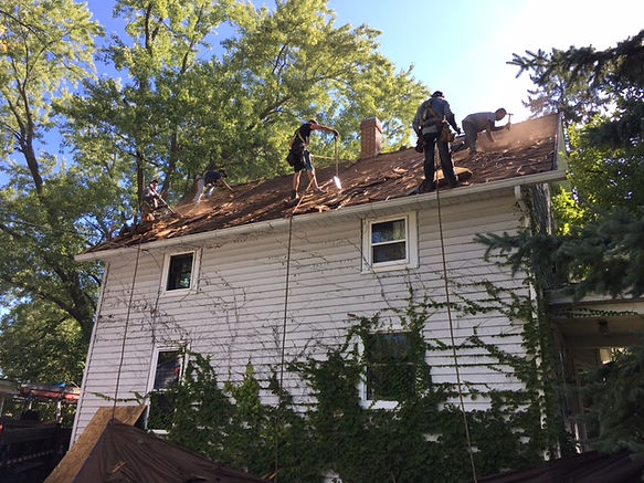 Roofers working with safety lines