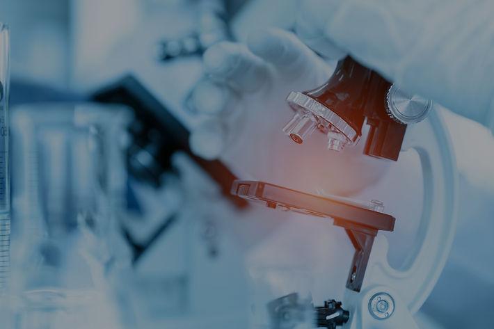 close-up-scientist-using-microscope-in-l