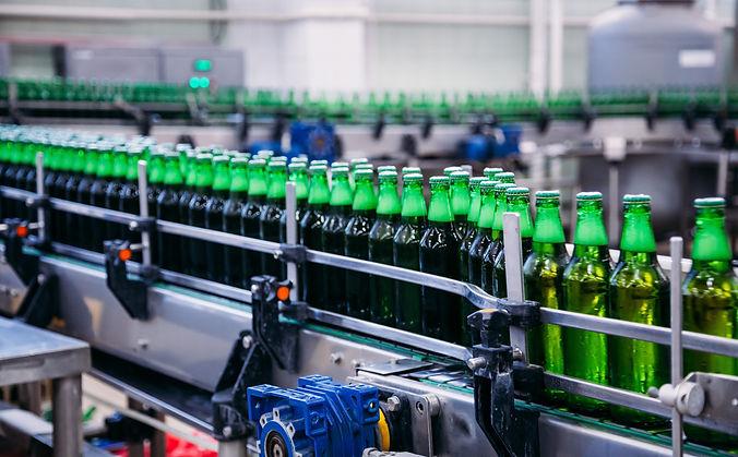 SAFEgroup Automation image of multiple beverages on a conveyor belt