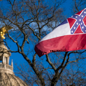 Mississippi governor signs bill to remove flag with controversial Confederate emblem