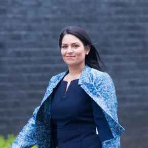 Priti Patel condemned after backtracking on scrapping immigration health surcharge