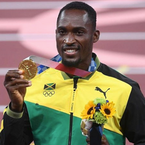 Jamaican gold medalist tracks down volunteer who helped him get to his race after he got wrong bus
