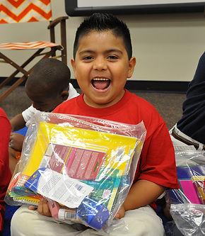 Boy-with-bag-of-school-supplies.jpg