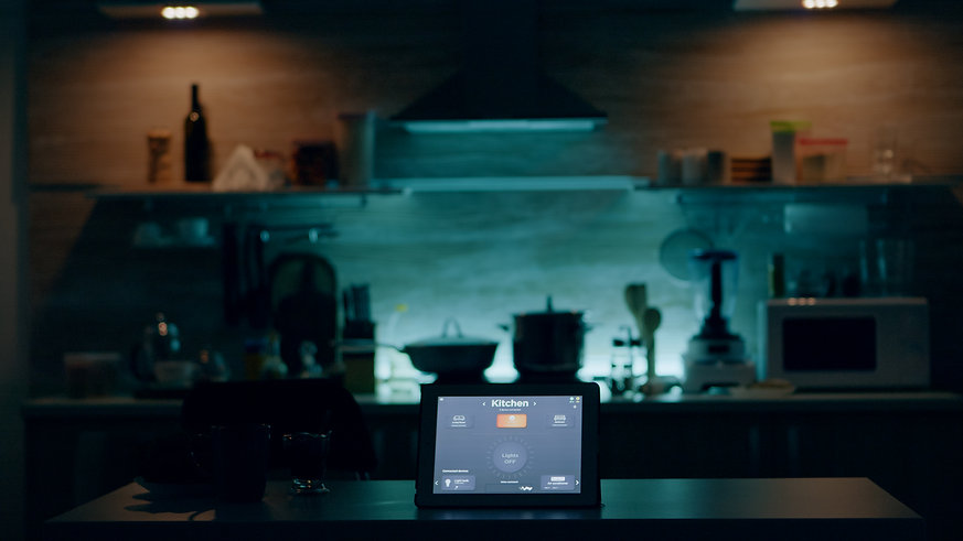 smart-application-on-tablet-placed-on-kitchen-desk-in-empty-house-automation-system-turnin