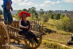 Burmese lady hitching a ride