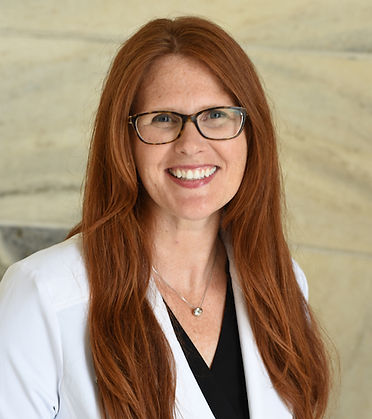 Headshot of Dr. Angie Weber wearing a white coat over a black shirt.