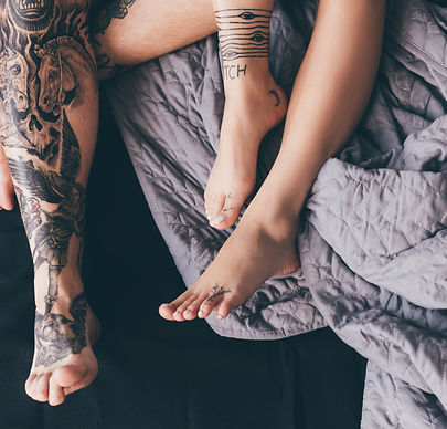 Canva - tattooed couple in bed.jpg