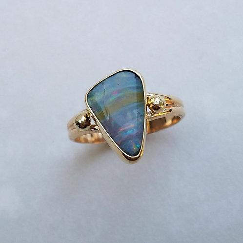 Boulder opal in gold