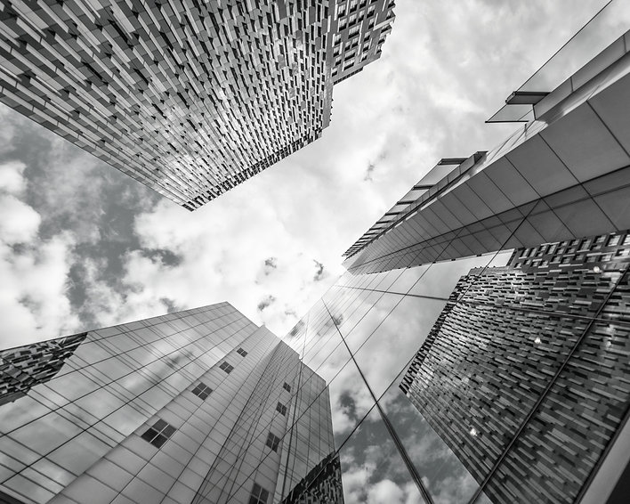 low-angle-photography-of-glass-buildings