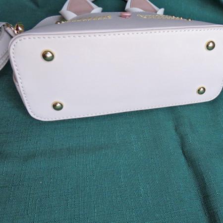Bottom of purse.