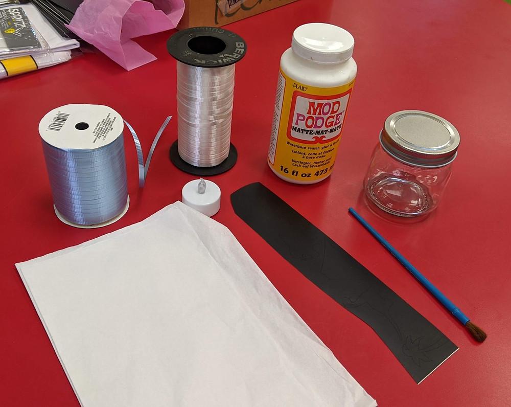 ribbon, glue, paintbrush, tissue paper, jar, vinyl