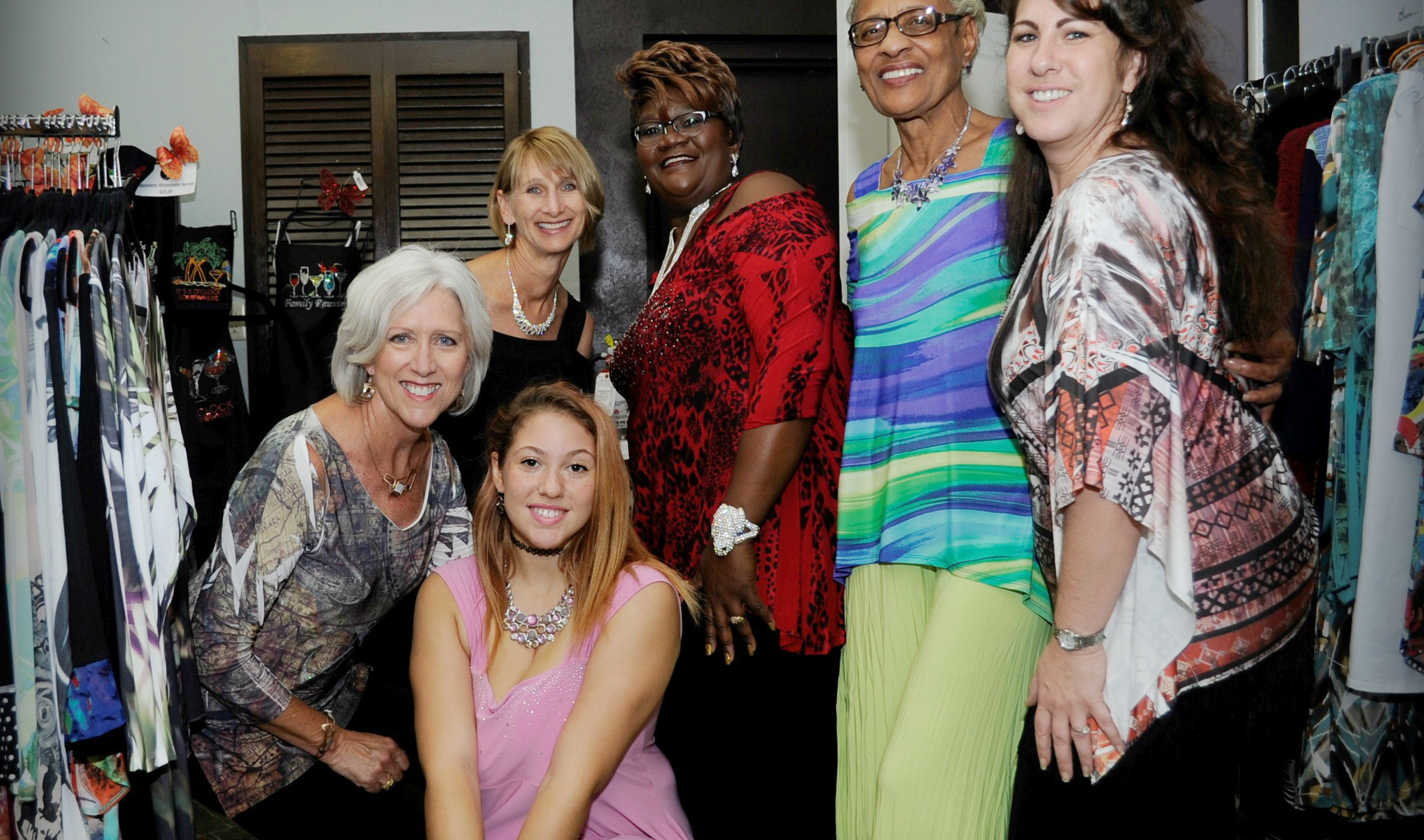 Shara Brodsky (right), Design Consultant at Chez Jacqueline Gift Shop with fashion show models behind the scenes
