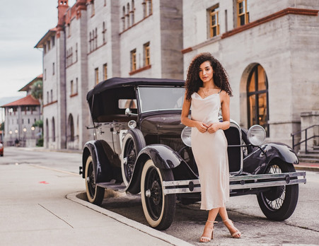Fashion model and vintage car