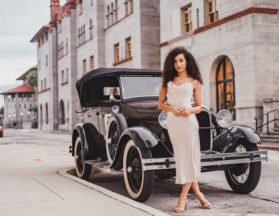 Fashion model and vintage car