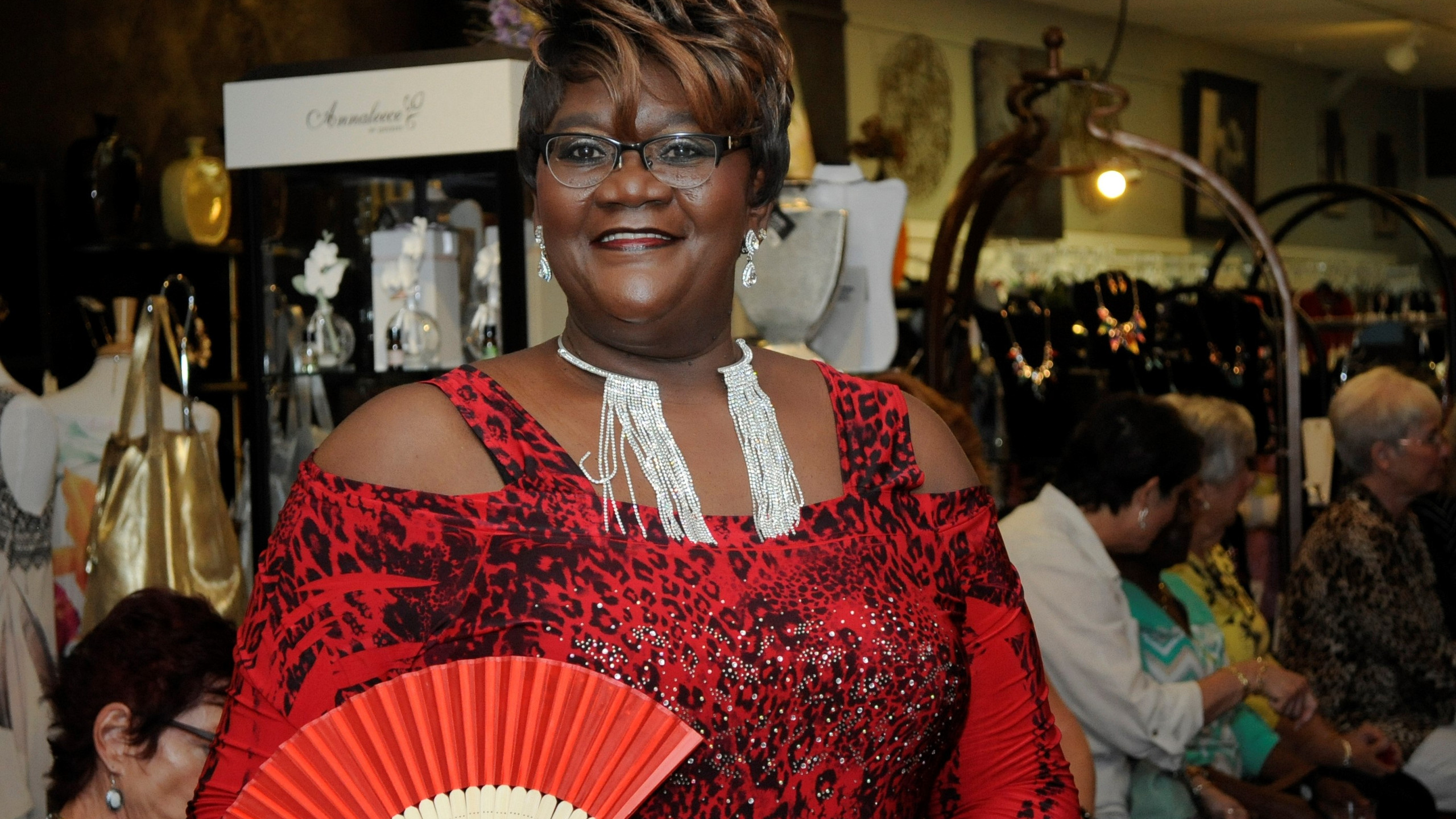 Lady in red at Chez Jacqueline Gift Shop in Palm Coast fashion event hosted by The Sheltering Tree