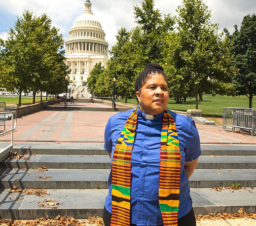 Rev Wendy Hamilton standing in front of the United States capitol building